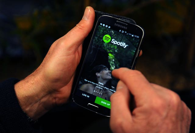 The Spotify App is shown on a Samsung smartphone.