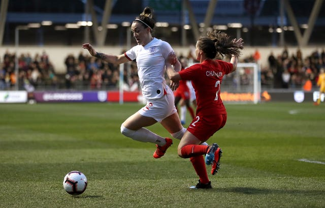 England's Lucy Bronze (left) and Canada's Allysha Chapman battle for the ball