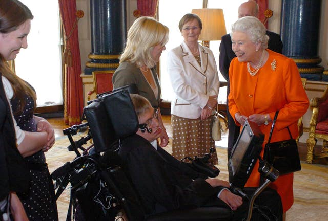 The Queen meets Professor Stephen Hawking and Lucy Hawking in the Music Room at Buckingham Palace (PA)