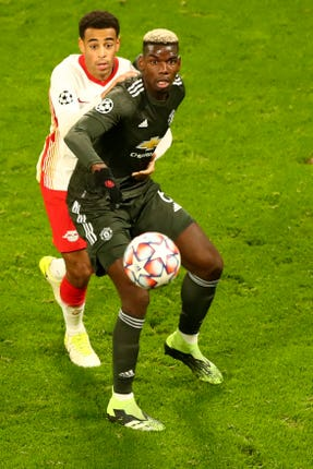 Bruno Fernandes and Paul Pogba (right) scored late goals in a galling 3-2 defeat