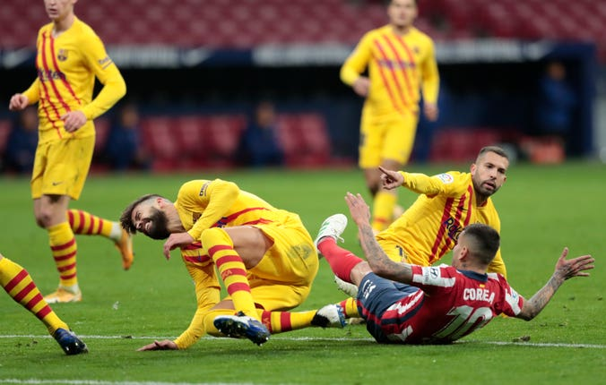 Barcelona defender Gerard Pique (left) was forced off injured following an awkward fall