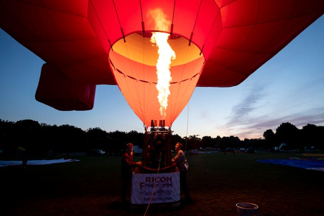 A hot air balloon prepares to take off from Battersea Park