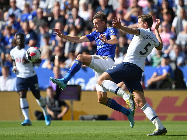 Jan Vertonghen, right, battles for possession with Leicester's Jamie Vardy