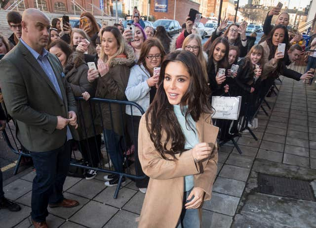 Fans gathered to see Cheryl arrive at the centre (Danny Lawson/PA)