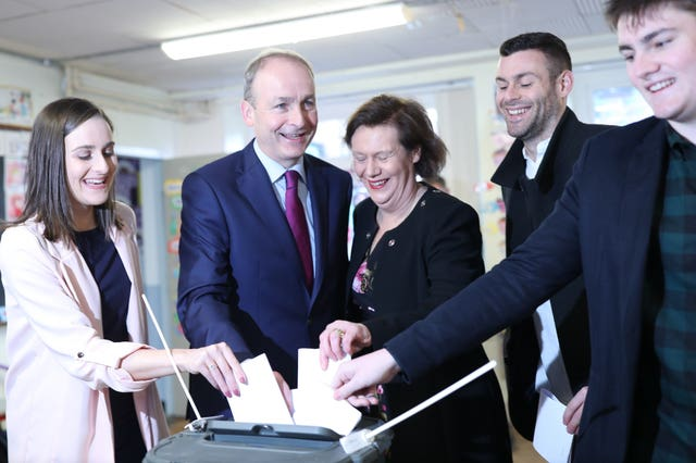Fianna Fail leader Micheal Martin and family vote at St Anthony's Boys National School in Ballinlough, Cork