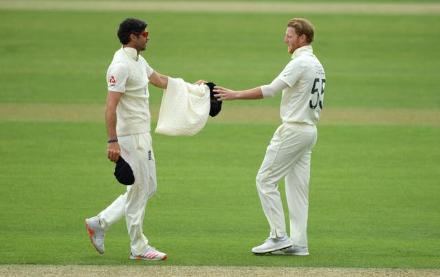 James Anderson gives his jumper to captain Ben Stokes