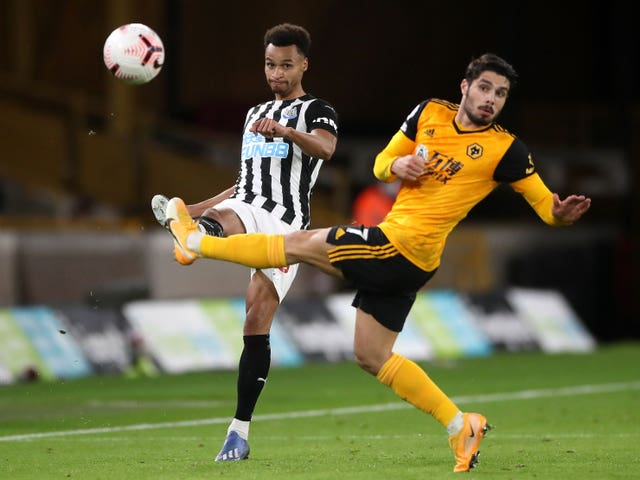 Jacob Murphy, left, and Wolves' Pedro Neto battle for the ball
