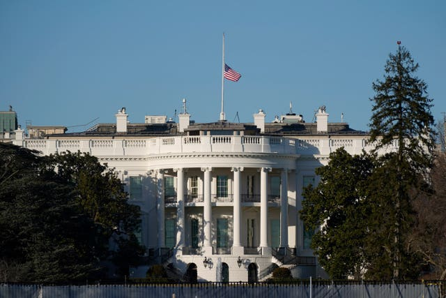 A US flag flies at half-mast above the White House in Washington (Patrick Semansky/AP)