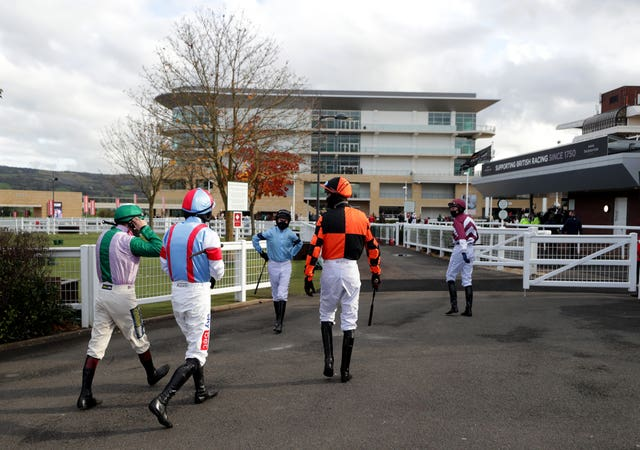 Jockeys make their way out to the paddock at Cheltenham