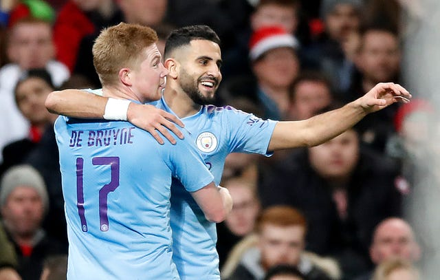 Kevin De Bruyne celebrates Manchester City's second goal with Riyad Mahrez