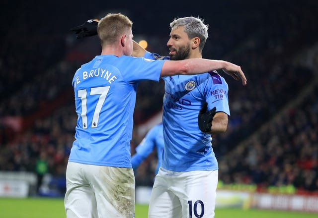 De Bruyne (left) has provided six assists for Sergio Aguero (right)