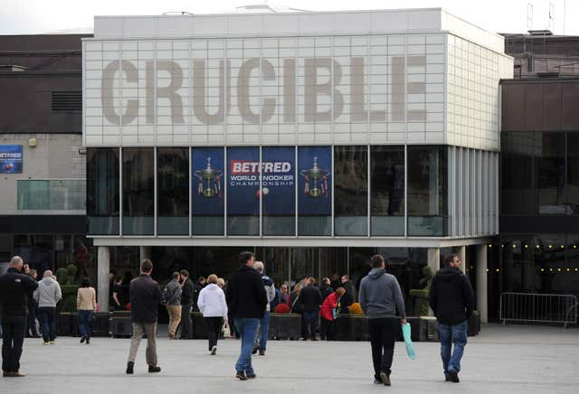 Snooker fans arrive at the Crucible Theatre
