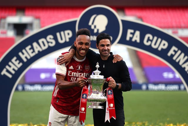 Arsenal's Pierre-Emerick Aubameyang (left) and manager Mikel Arteta celebrate their FA Cup final victory at Wembley