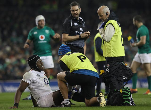 Maro Itoje receives treatment after picking up a knee injury