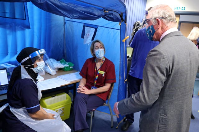 The Prince of Wales meets with front line health and care workers administering and receiving the Covid-19 vaccine (Chris Jackson/PA)