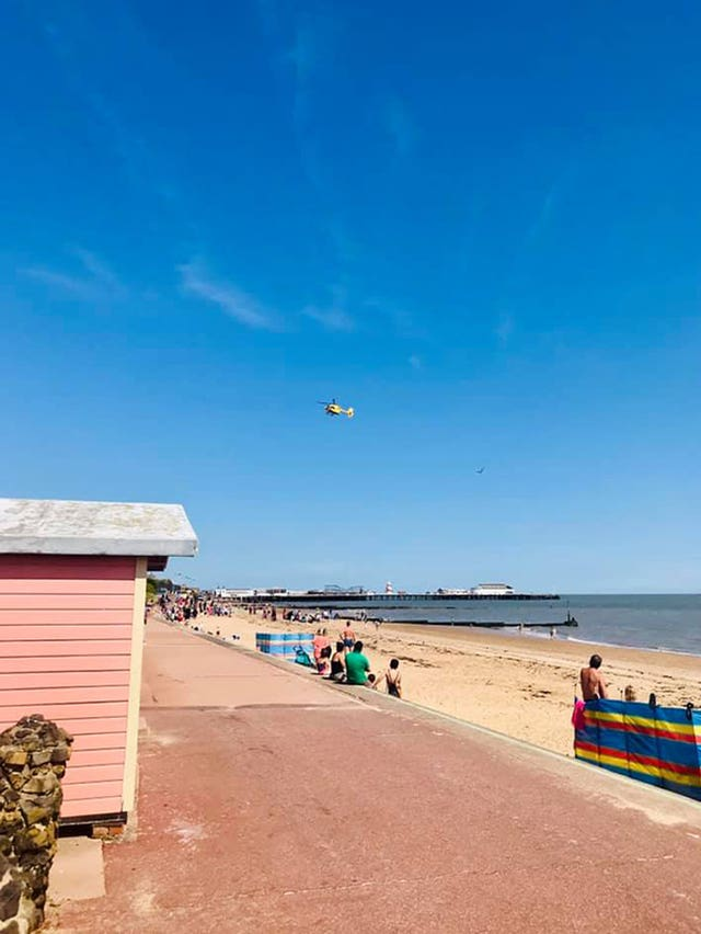 An emergency services helicopter above Clacton beach in Essex