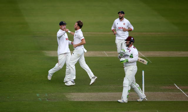 Essex paceman Sam Cook (centre) claimed a five-wicket haul