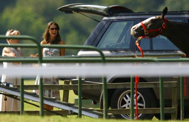 Prince William's girlfriend watches him play polo