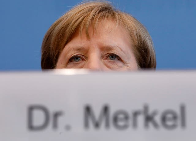 German Chancellor Angela Merkel takes part in a news conference about the coronavirus outbreak in Germany in Berlin