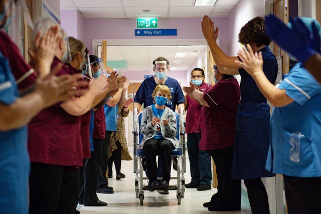 Margaret Keenan, 90, applauded by staff as she returned to her ward after she became the first person in the United Kingdom to receive the Pfizer/BioNtech covid-19 vaccine at University Hospital, Coventry , at the start of the largest ever immunisation programme in the UK's history