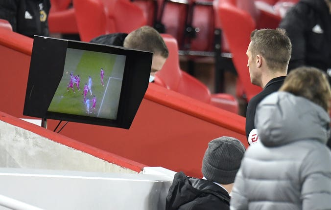 The referee checks the monitor