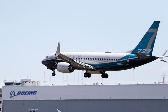A Boeing 737 Max heads to a landing at Boeing Field in Seattle (Elaine Thompson/PA)