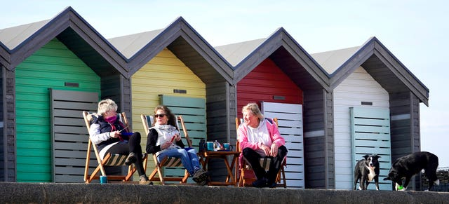 Ladies enjoy lunch in the sun at Blyth in Northumberland on Monday
