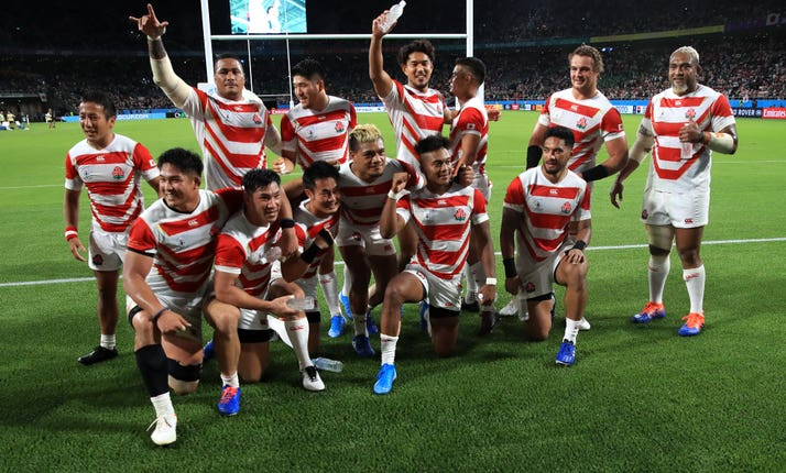 Japan's players celebrate their famous victory over Ireland