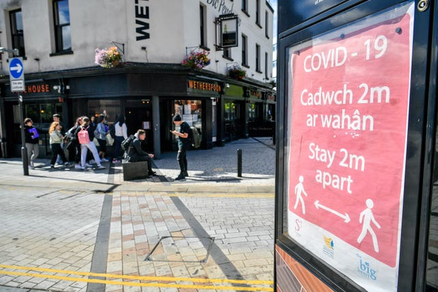 A Covid-19 poster opposite a pub in Merthyr Tydfil (Ben Birchall/PA)