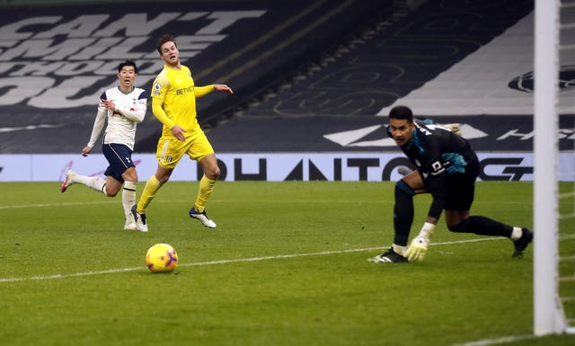 Tottenham striker Son Heung-min watches as his shot goes past a post
