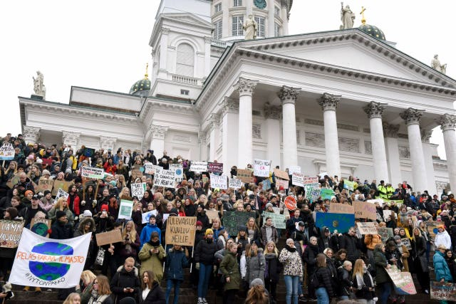 Young demonstrators on the steps of Helsinki Cathedral