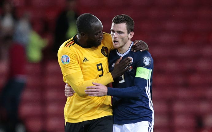Romelu Lukaku, left, consoles Andy Robertson after the game