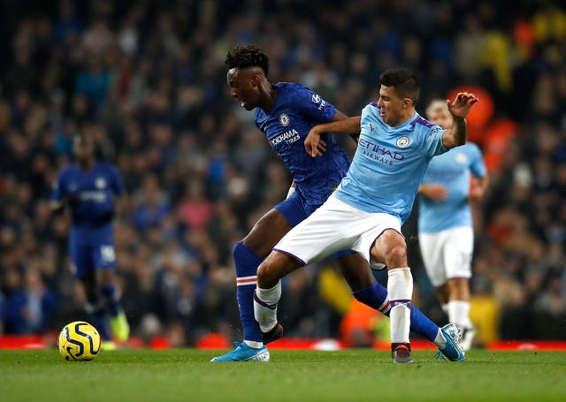 Rodri (right) is determined to battle through City's tough period