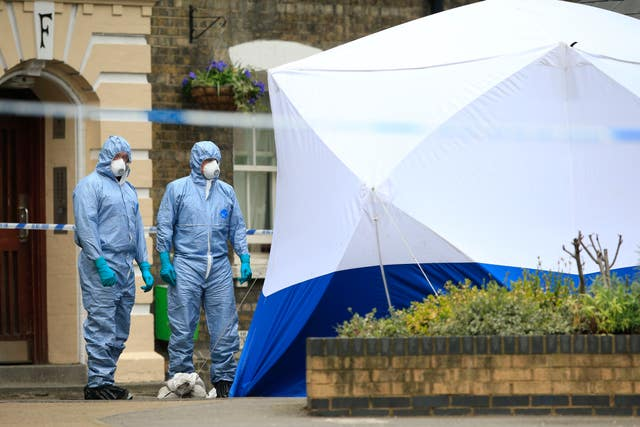 Police forensic officers after the remains of Gordon Semple were found (Jonathan Brady/PA)