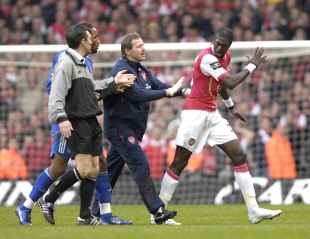 Arsenal's Emmanuel Adebayor was one of three players sent off following a last-minute fracas in Cardiff.