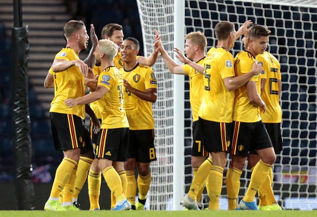 Toby Alderweireld, left, celebrates with team-mates after scoring Belgium's third goal