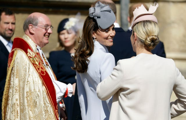 The Duchess of Cambridge shares a smile with Zara Tindall outside the church