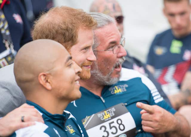 The Duke of Sussex poses for a photo with Invictus athletes