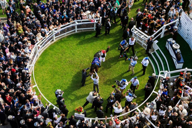 Frankie Dettori leaps from Golden Horn in the winner's enclosure after victory in the 2015 Derby at Epsom. His 20th Derby ride brought a second victory in the race for Italian-born rider Dettori, who triumphed for the first time at the 15th attempt on Authorized in 2007