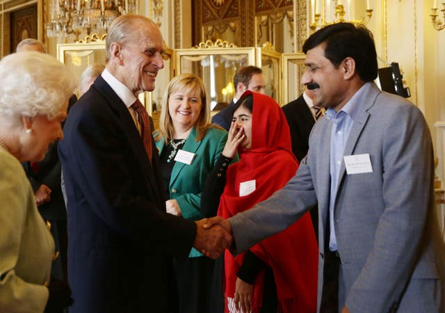 Philip with Malala Yousafzai