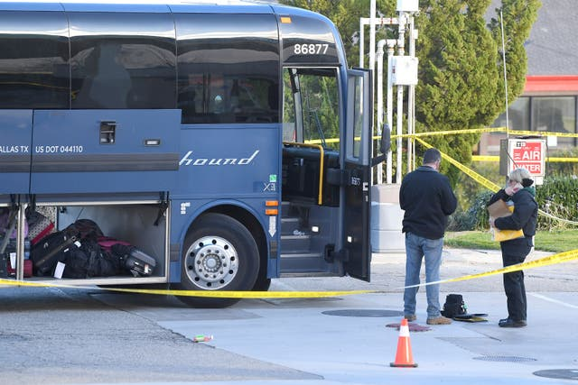 Investigators outside a Greyhound bus after a passenger was killed on board in Lebec, California