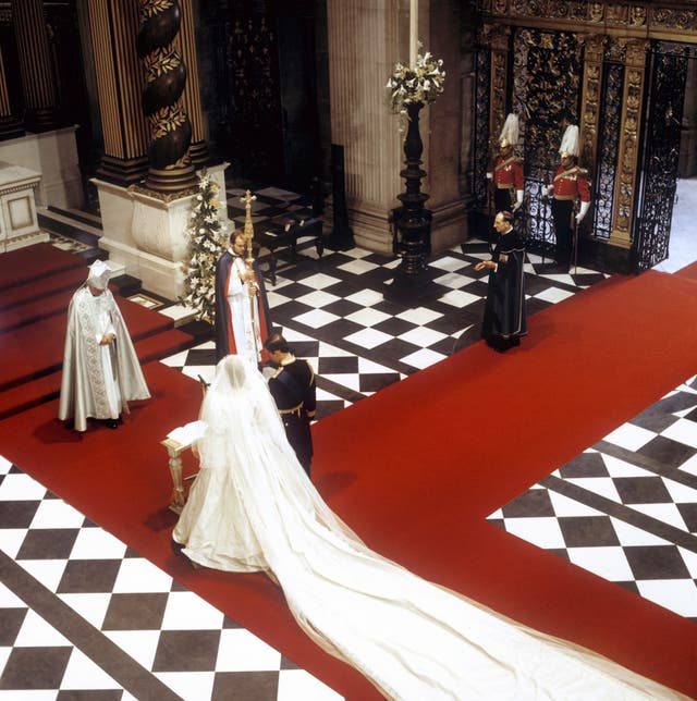 The Prince and Princess of Wales at the High Altar in front of the Archbishop of Canterbury during their wedding at St Paul's Cathedral (PA)
