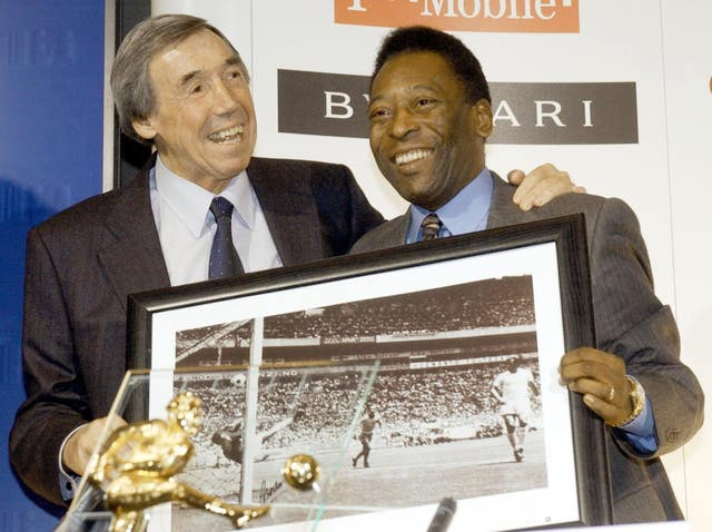 Banks, left,with a picture of his famous save from Brazil striker Pele
