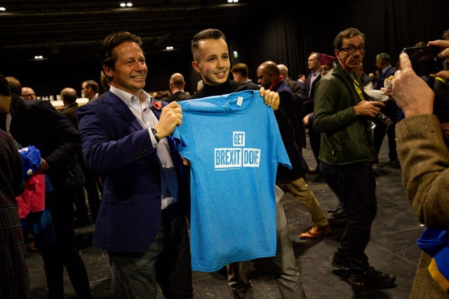 T-shirts are handed out before the Conservative campaign launch for the 2019 General Election at the NEC in Birmingham