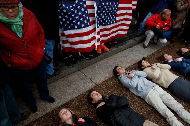 "Demonstrators participate in a ""lie-in"" during a protest in favour of gun control reform in front of the White House (AP Photo/Evan Vucci)"