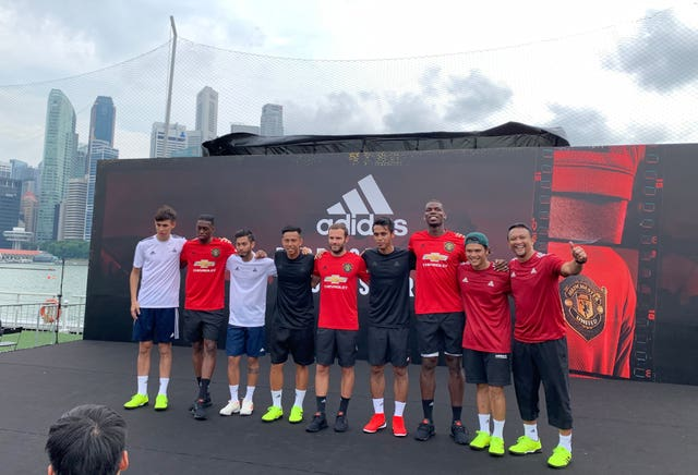 Manchester United's Aaron Wan-Bissaka, Paul Pogba and Juan Mata on stage during the Adidas event in Singapore