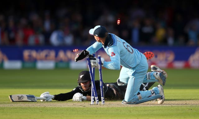 Jos Buttler, right, runs out Martin Guptill in the World Cup final from Jason Roy's throw