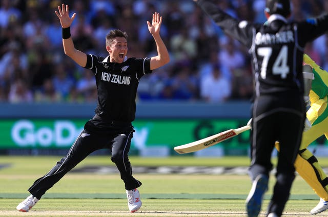 New Zealand's Trent Boult, left, celebrates his hat-trick against Australia