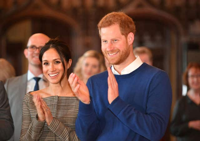 Prince Harry and Meghan Markle watch a performace (Ben Birchall/PA)