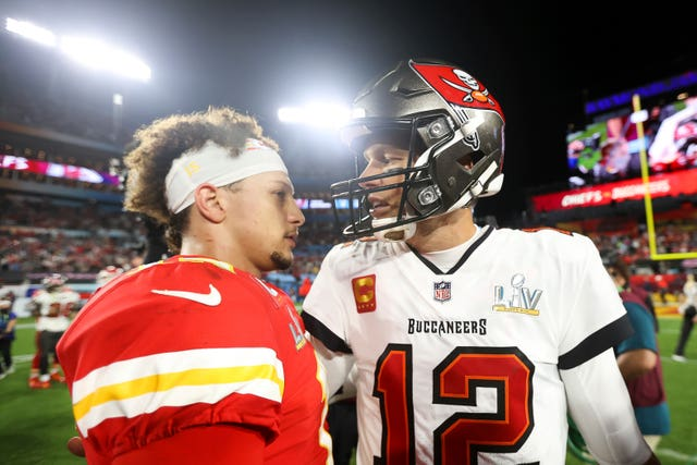 Kansas City Chiefs quarterback Patrick Mahomes and Tampa Bay Buccaneers quarterback Tom Brady  embrace following the Super Bowl 55